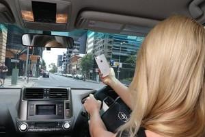 昆士兰司机注意开车用手机 下个月起扣分加倍